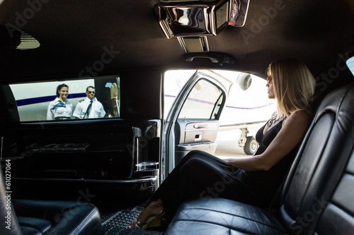 Elegant Woman In Limousine At Airport Terminal