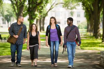Friends Walking On Campus Road