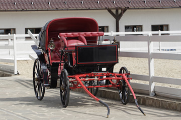 Vintage horse drawn carriage in stable parking