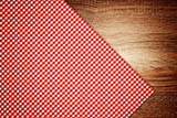 Table cloth, kitchen napkin on wooden background.