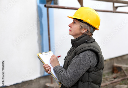 Inspector at construction site examine works