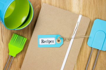 top-view of a recipe book with kitchen utensils