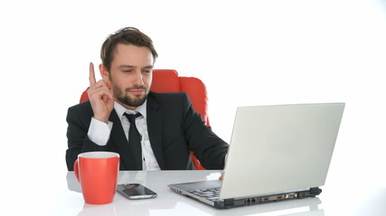 Businessman sitting working at his laptop
