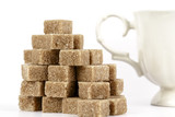Brown sugar cubes and a cup