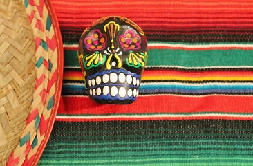 fiesta serape stripe background candy skull sombrero