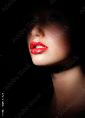Woman with Red Lips in Shadows. Spotlight