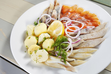 Fish assortment with boiled potatoes