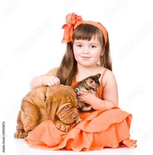 happy girl and her pets - a dog and a kitten. isolated on white