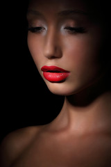 Accent. Highlight. Exotic Asian Woman in Shadows. Evening Makeup