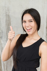 smiling woman showing thumb up, positive attitude
