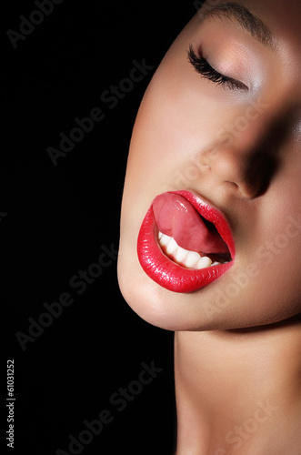 Carnality. Lust. Woman Licking her Red Sexy Lips. Passion
