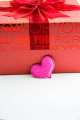 Red gift box and pink heart