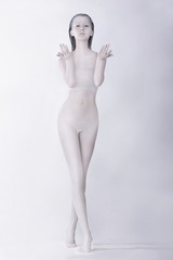 Fantasy. Surreal Bodypainting. Woman Colored White. Creative Art