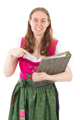 Beautiful woman in dirndl happy about her success