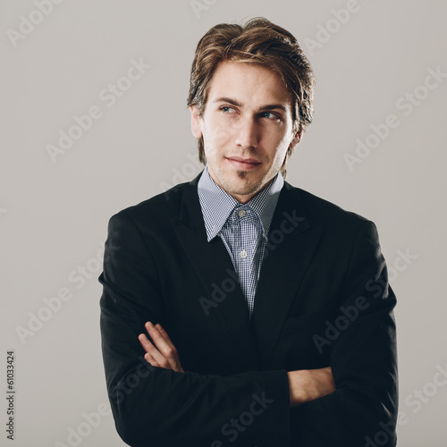 Confident businessman deep in thought
