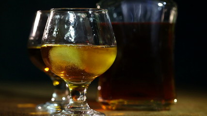 Cognac, brandy and ice. Alcohol close up