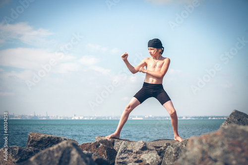 Young boy training karate