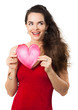Smiling woman holding red love heart.