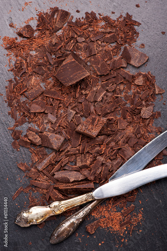 chocolate pieces and grated chocolate on a slate chalkboard