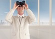Composite image of confident businessman with binoculars