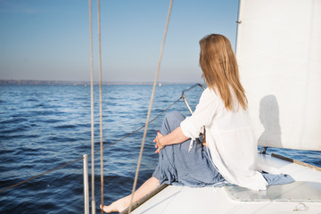 woman sitting on sailboat