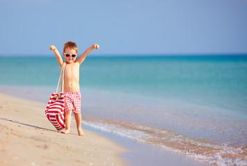 happy kid walking the summer beach