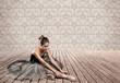 attractive ballerina sitting