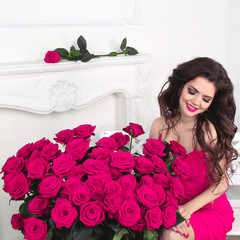Enjoying beautiful woman with gorgeous roses bouquet, valentines