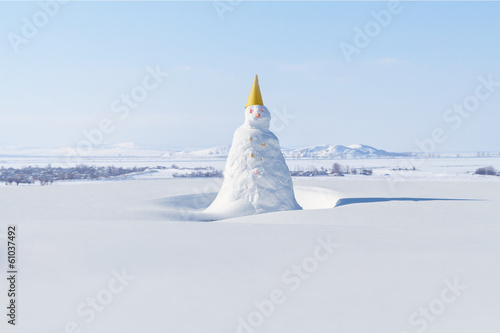 Snowman. Background of fresh snow