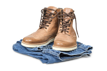 Hiking boots and blue jeans isolated with clipping path.