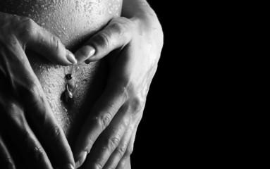 Woman's hands on wet skin