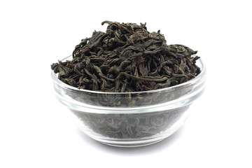 dried black tea leaves in a glass container