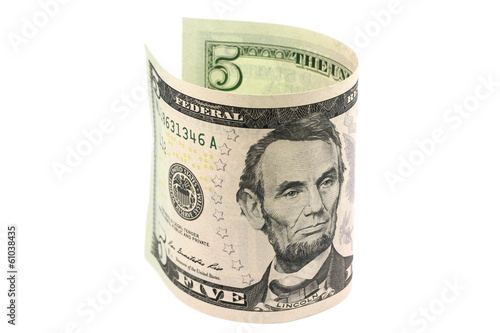 Five dollars rolled in a roll on a white background