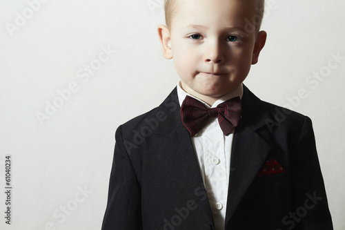 Handsome Little Boy in Black Suit.Stylish Child with Blue Eyes