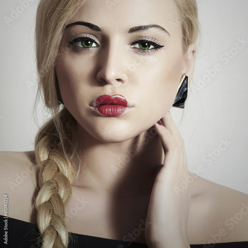 Beautiful Blond Woman with Freaky Make-up.Freak Girl with Tress