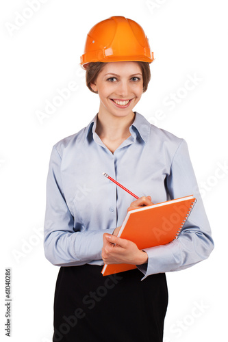 Cute woman engineer in protective helmet