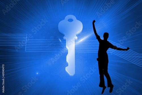 Composite image of glowing key on blue background