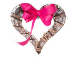 Dark wooden handmade heart and ribbon on a white background