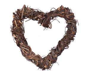 Dark wooden handmade heart on a white background