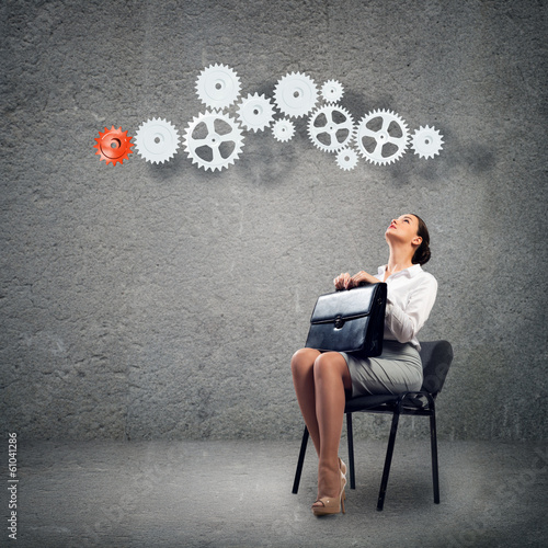 young business woman looking at the mechanism