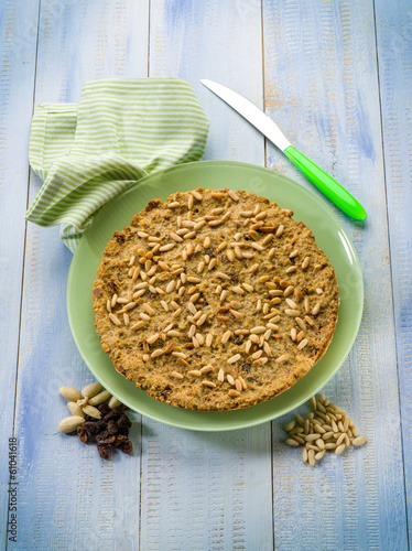 bread cake with almond pine nuts and dried grape