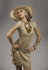 Beautiful blonde woman in safari outfit