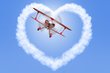 Biplane creating a heart shape in the sky