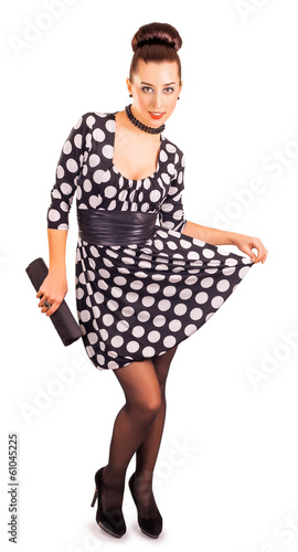 sexy lady in a polka dot dress on a white