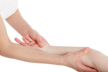 Massage therapist performing hand massage.