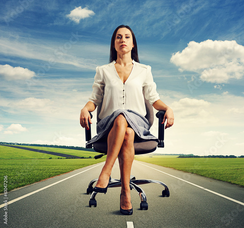 woman sitting in the office chair on road