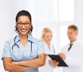 smiling female african american doctor or nurse