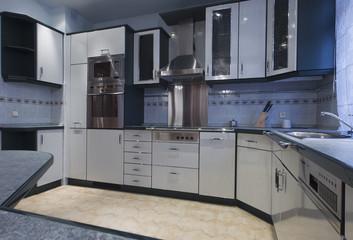 modern empty kitchen with stainless still appliances.