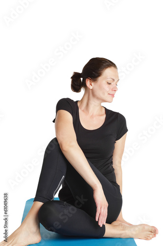 Active woman doing her exercise indoor.
