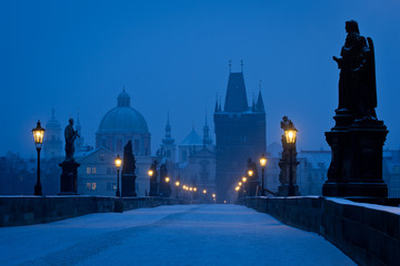 Famous Prague Charles bridge empty at early morning blue hour